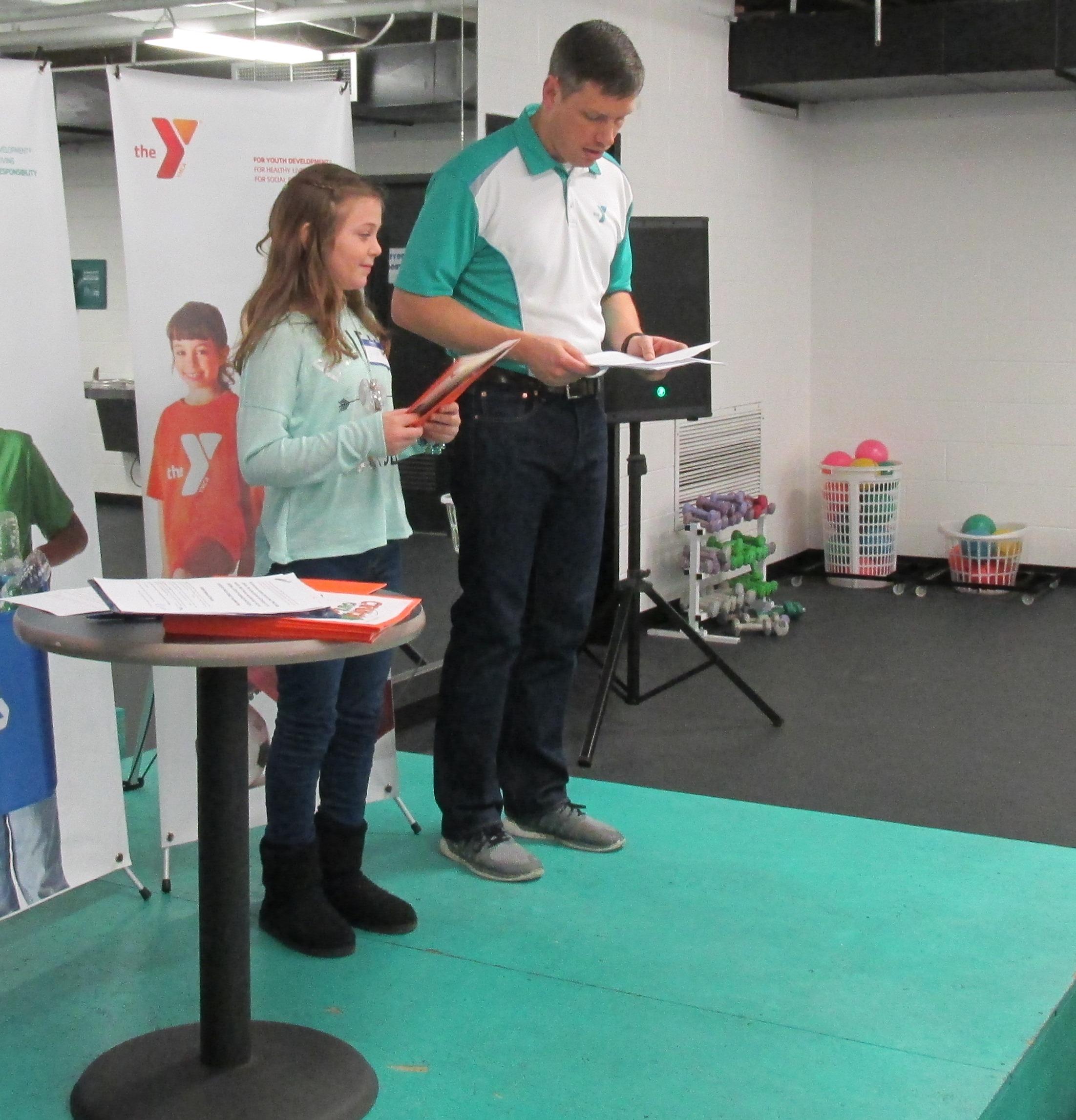 Nick Clark of YMCA recogizing Julia Partington - Fredericktown Overall School Winner