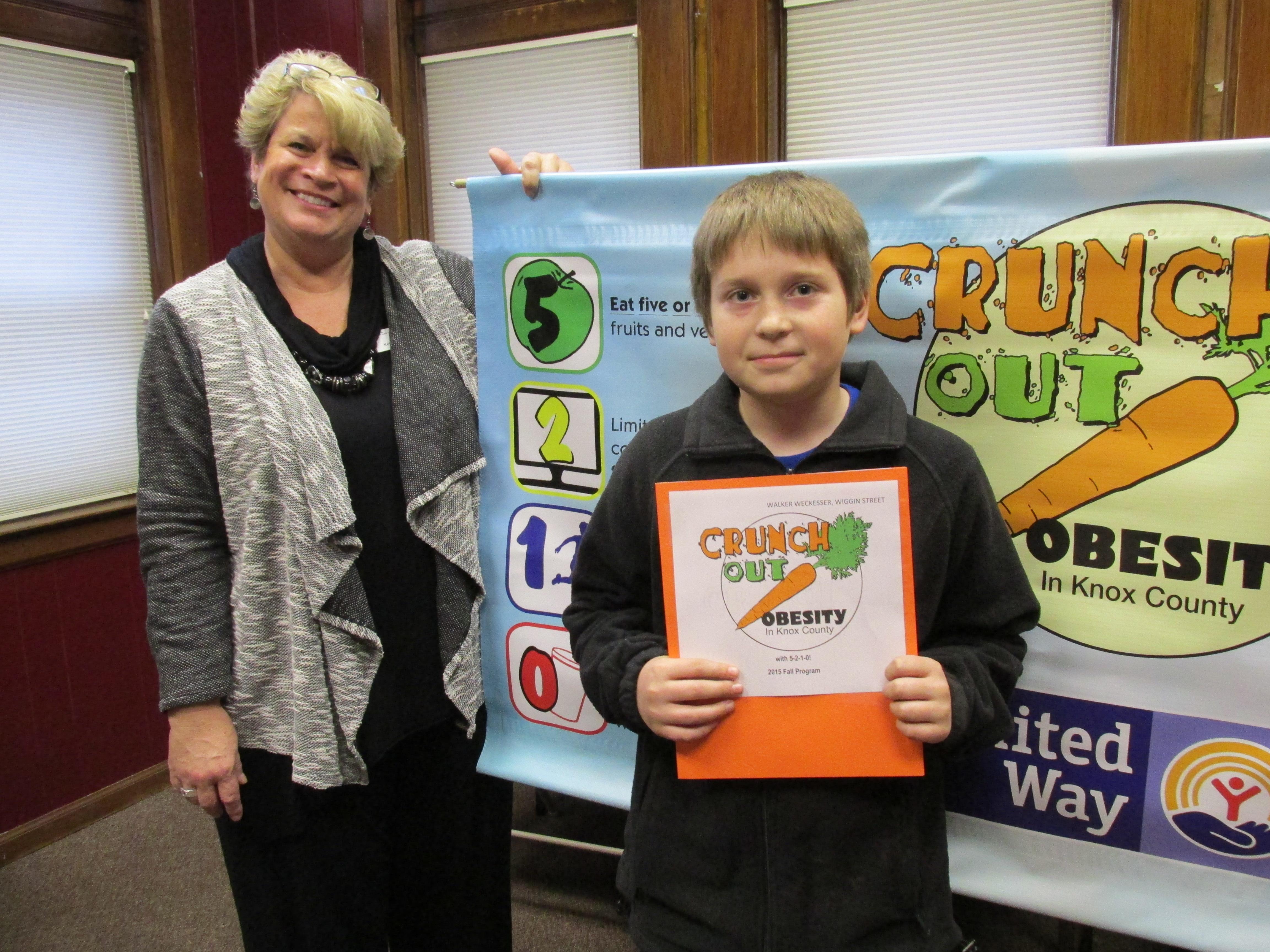 Walker Weckesser - Mrs. Sabo's classroom winner from Wiggin Street with Kelly Brenneman of United Way